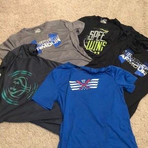 Lot of five Under Armour T-shirts.